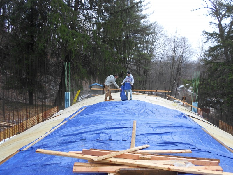 Tarping over the roof for working underneath.