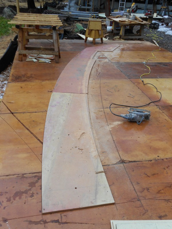 Tapered slab cut out on close up face of retaining wall curb.