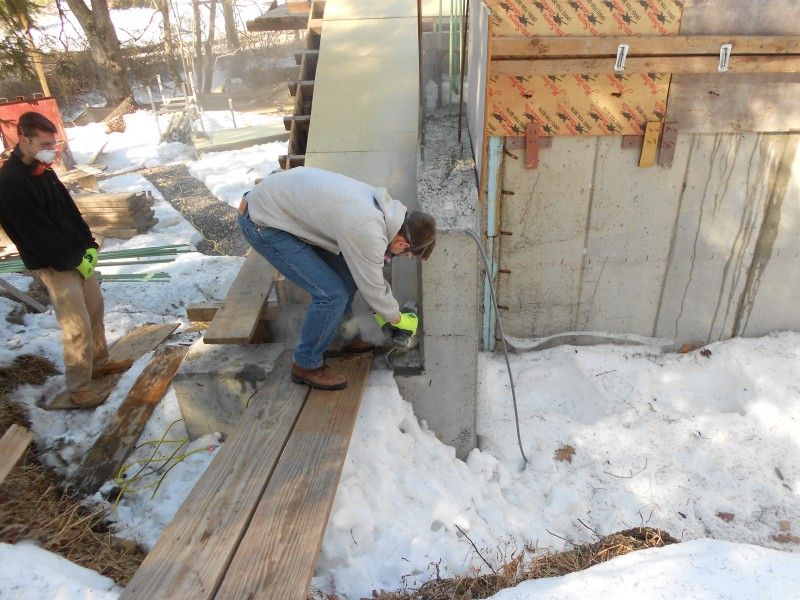 Terence scoring the concrete with a diamond blade.