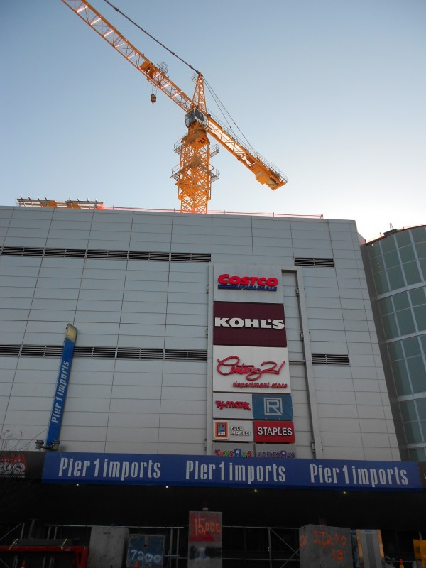 Hammerhead crane at Rego Park sitting on top of the mall.