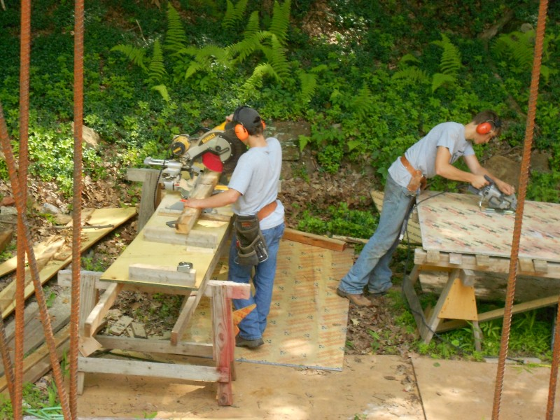 Paul working the chopsaw, Terence cutting the template.