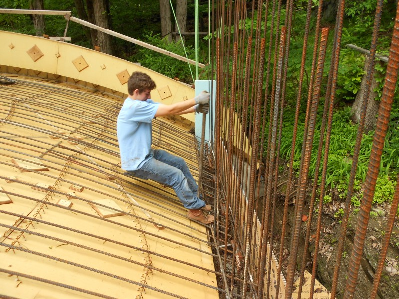 Zack using the hickey to bend the rebar into the slab.