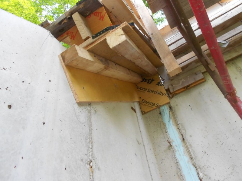 Add a side with a header on it and add a supporting 3x4 to take the weight of the concrete.