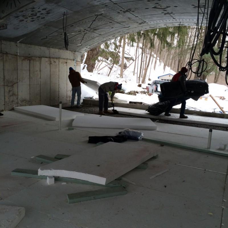 Men of Bree preping the styrofoam slab for the vapor barrier.