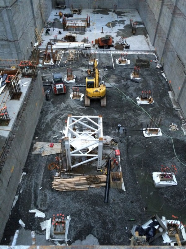 Tower base section in foundation