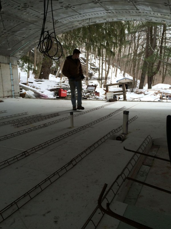 Laying out the slab chairs for the rebar mat.