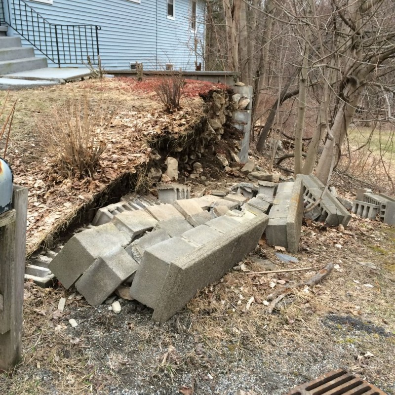 Retaining wall failure at Mother inLaws house.