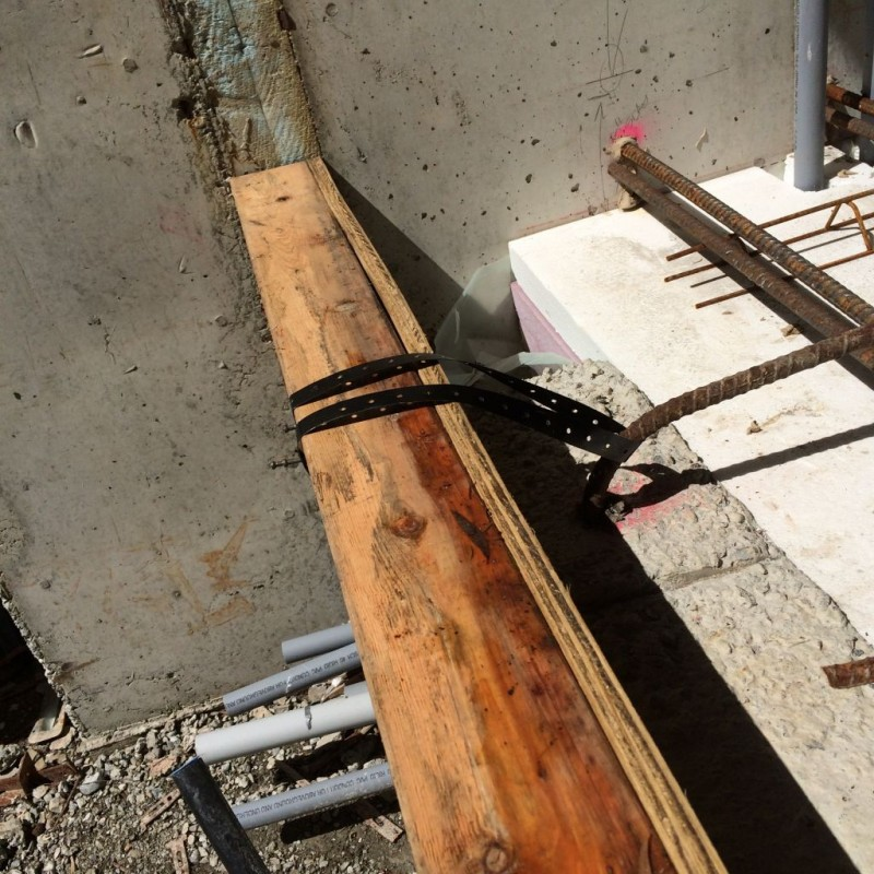 Banding wire wrapped around the rebar to hold the form in place.
