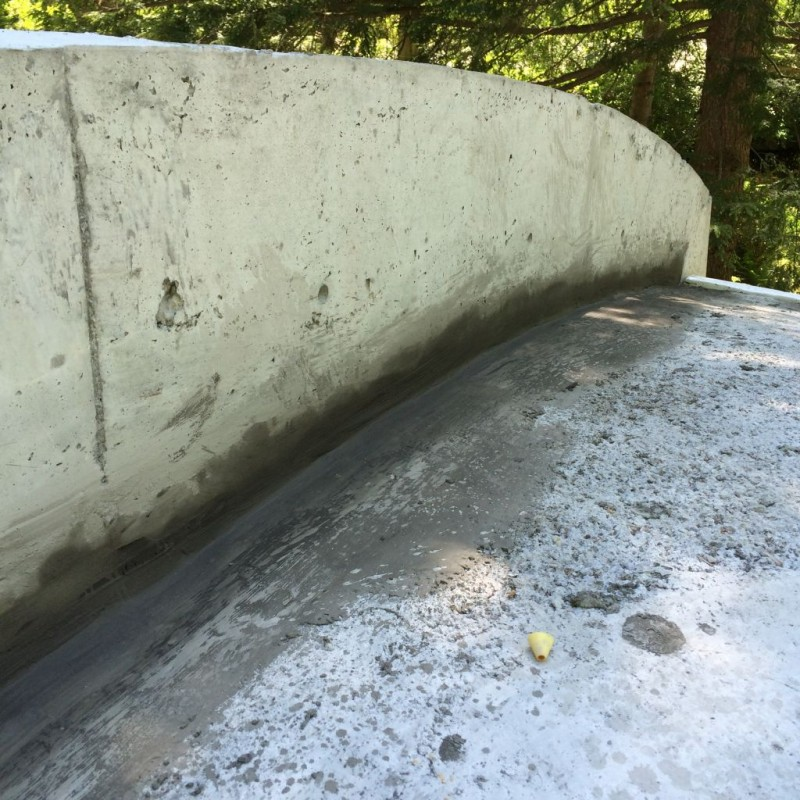 Patched retaining wall curb.