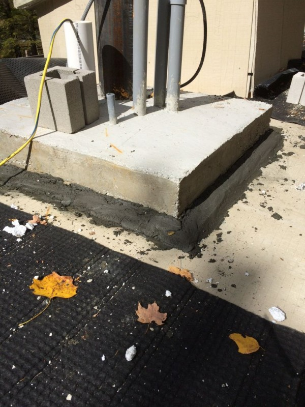 Chimney base with cement based cant to shed water as well.