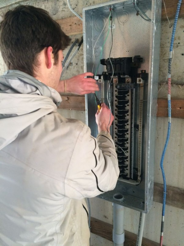 Ethan wiring the panel box.