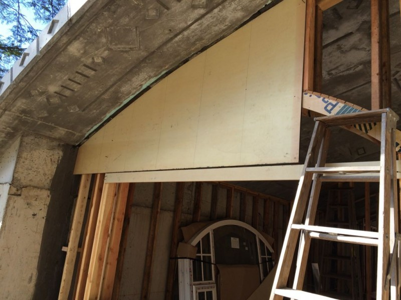 Sheathing temporarily held in place for scribing.