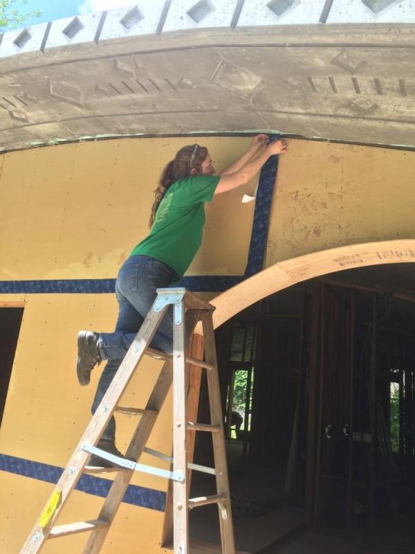 Georgia air sealing the plywood seams.
