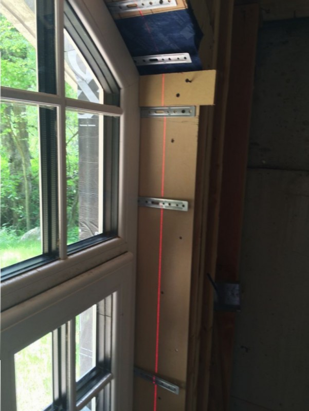 Plumbing the window with the laser level.