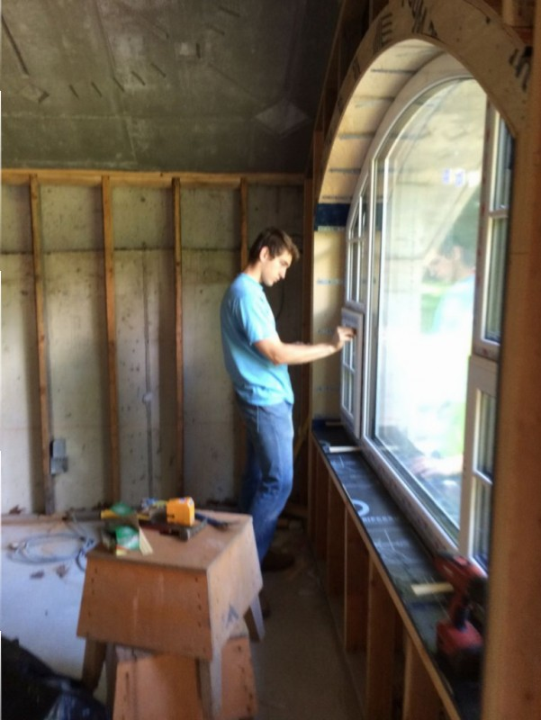 Terence peeling off the protective coating on the window.