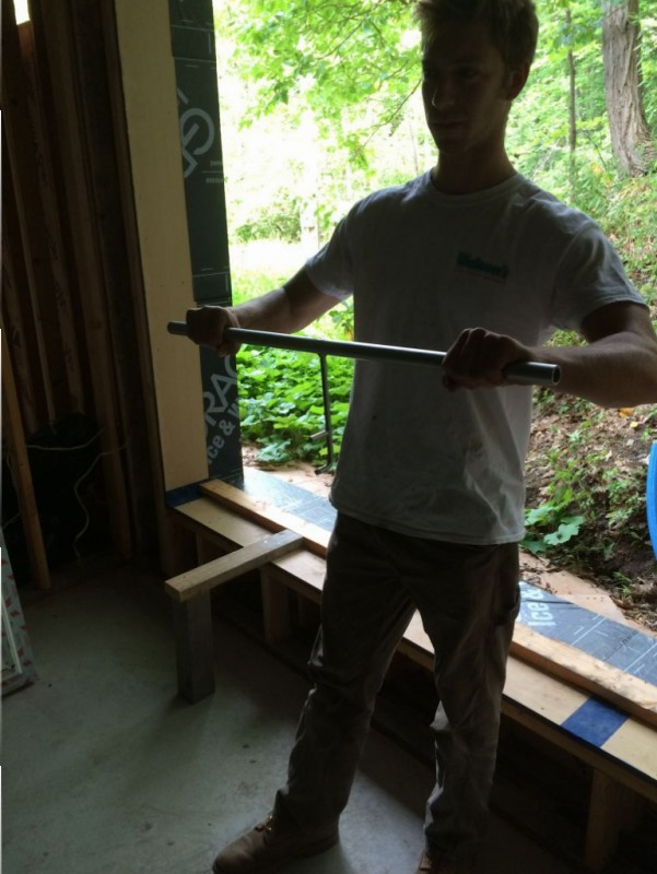 Ethan holding the lifting bar for the window.