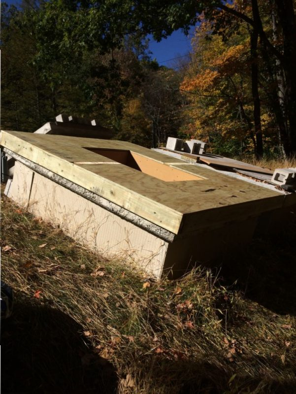 Pressure treated plywood in place for skylight and roofing shingles.