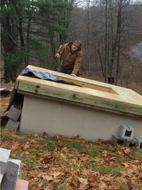 Terence nailing off the skylight plywood.